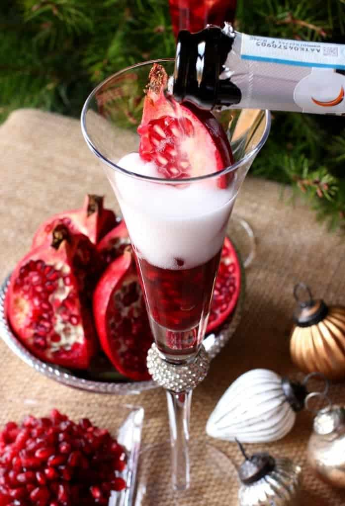 A Prosecco Holiday Pom Pom is a champagne drink recipe that has fresh pomegranate seeds