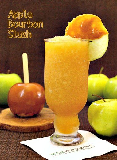 Apple Bourbon Slush is a cold cider and bourbon cocktail blended with ice