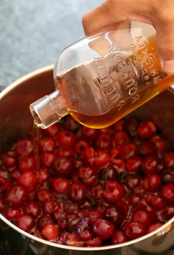 Pour in a good amount of bourbon to make this bourbon cherry pie filling!