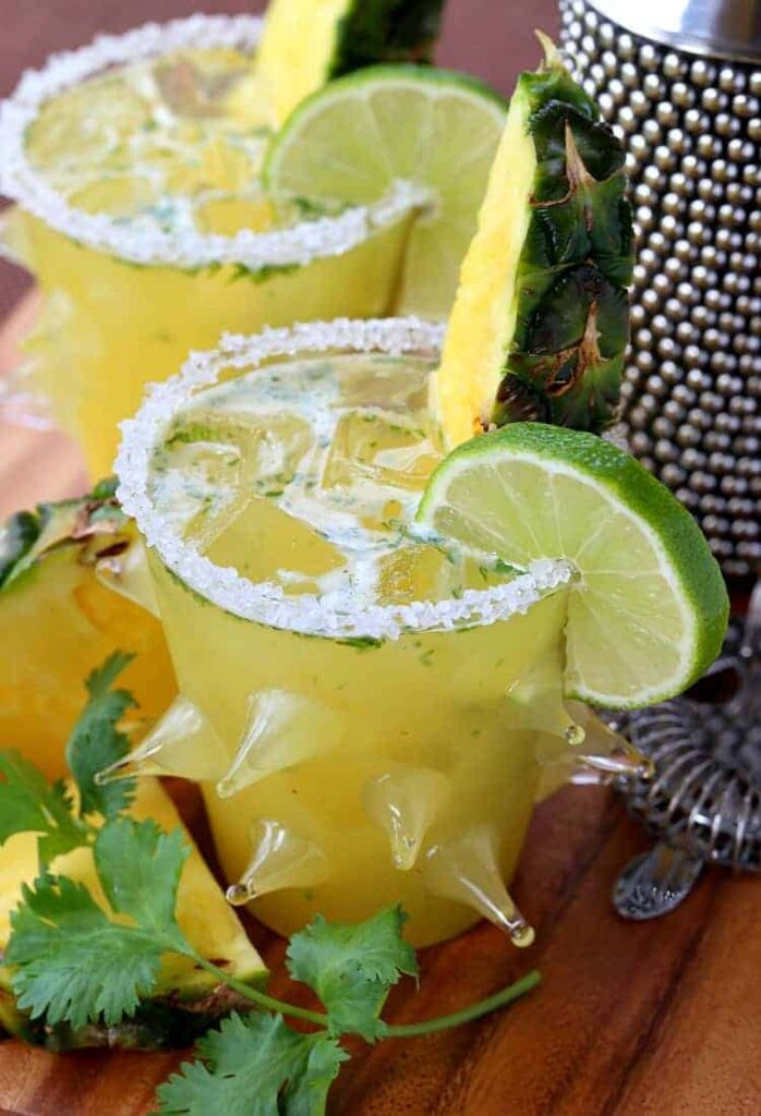This Spicy Pineapple Cilantro Margarita is a spicy margarita recipe with hot sauce