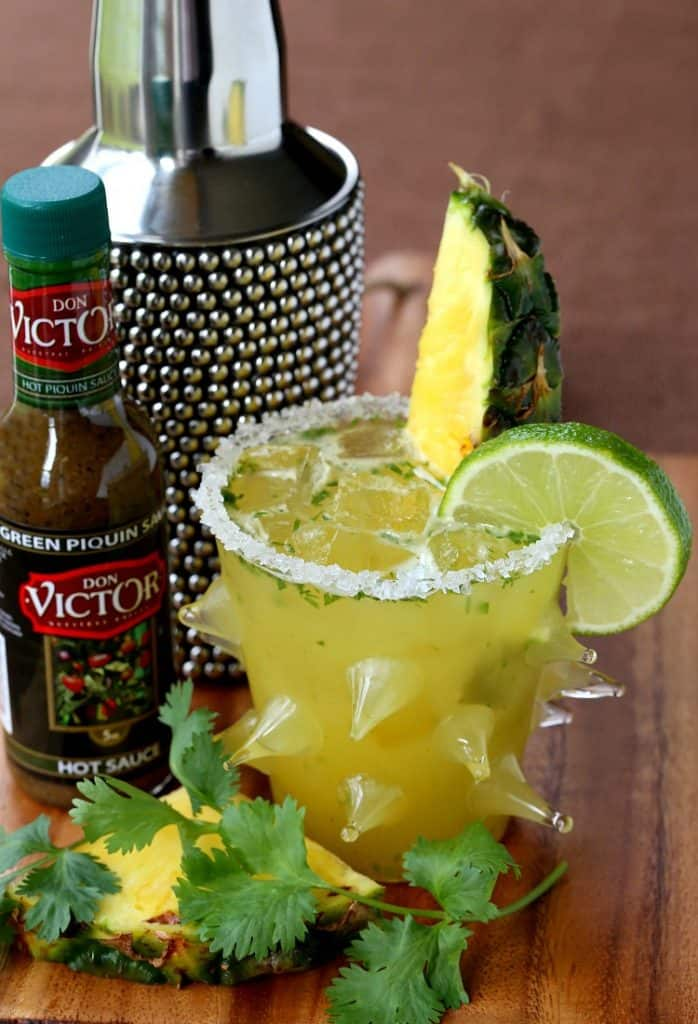 This Spicy Pineapple Cilantro Margarita is a tequila cocktail made with fresh pineapple and hot sauce