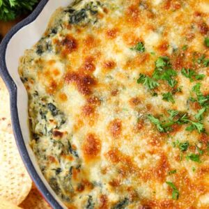 Skillet Spinach Artichoke Dip is a hot dip recipe topped with cheese and baked