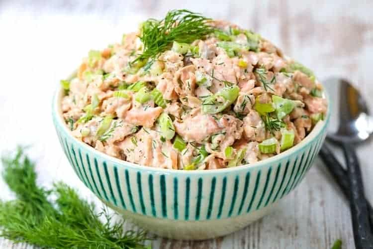 Salmon Salad recipe in a bowl with spoons and fresh dill