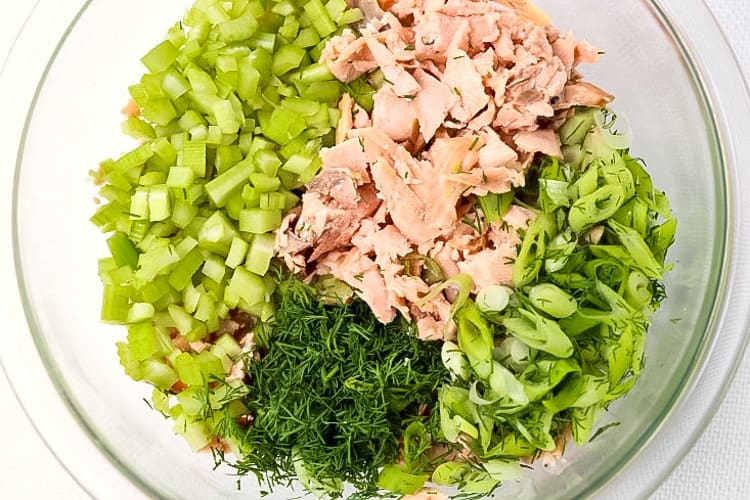 Salmon Salad Recipe uses fresh salmon and a few other ingredients mixed together in a bowl