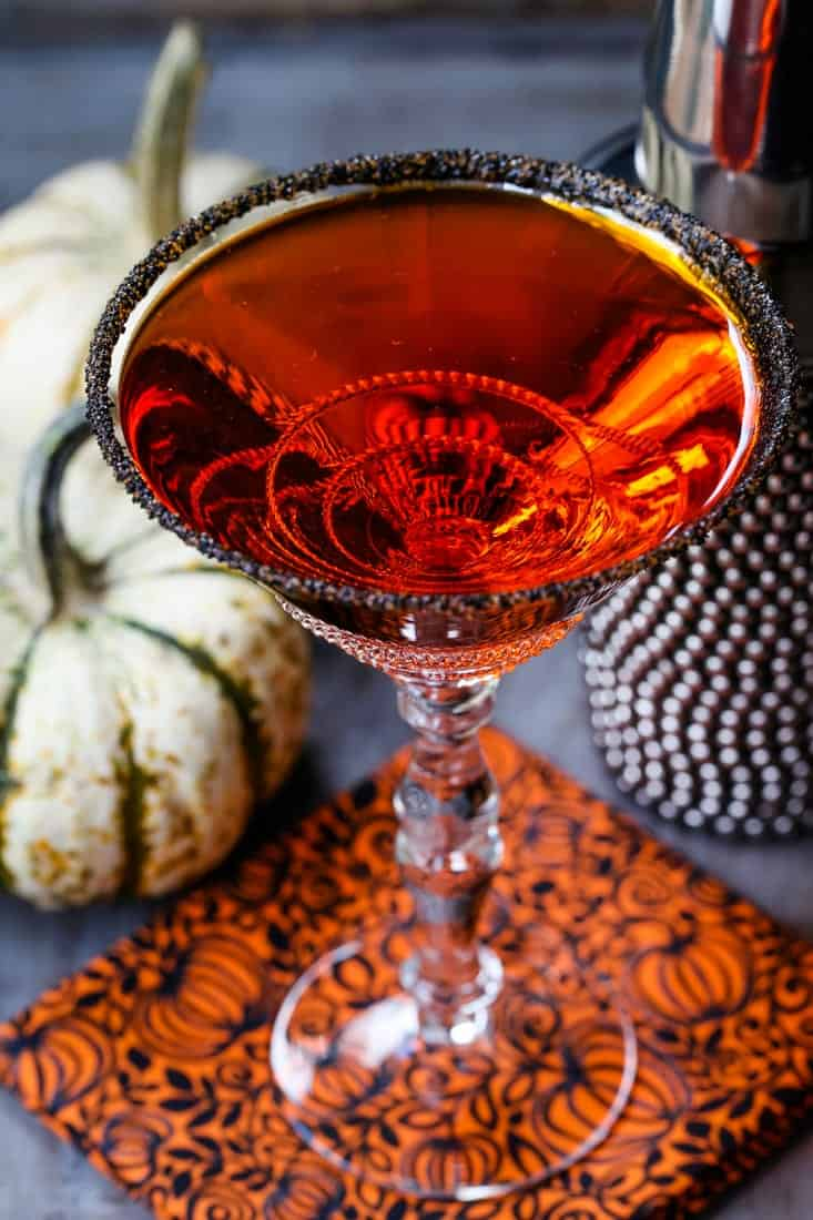 pumpkin drop martini with pumpkins in the background