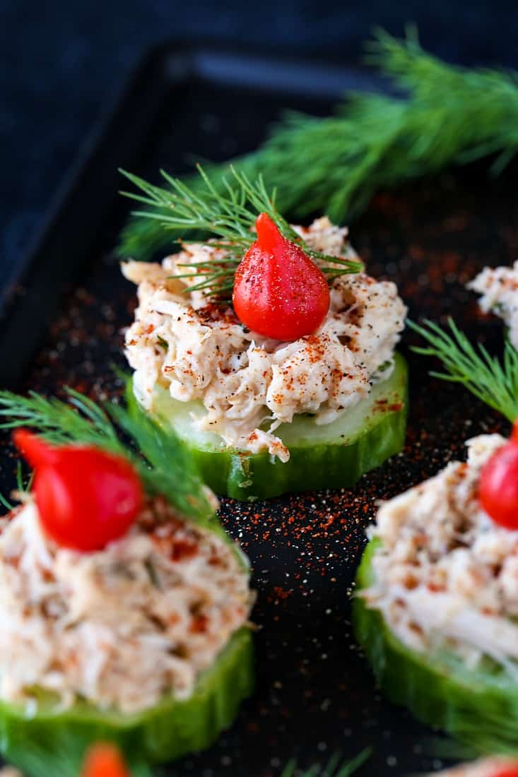 crab salad on top on cucumber slices with a red bell pepper