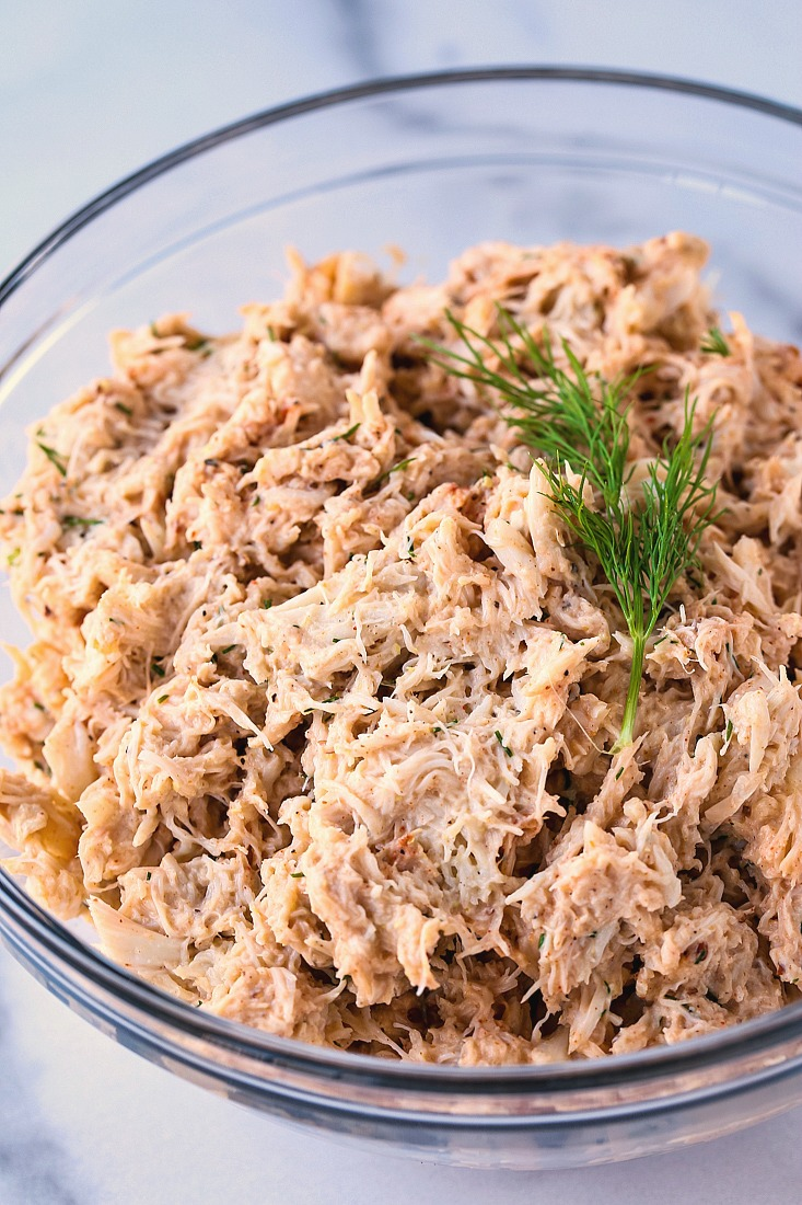 crab salad in a bowl with fresh dill