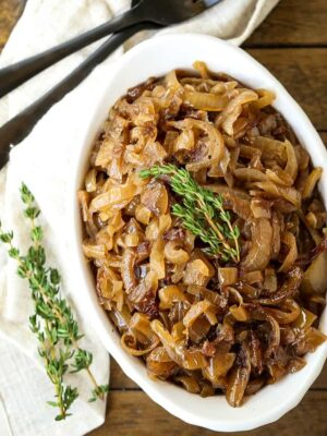 slow cooker caramelized onions in a white dish
