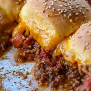 Beef casserole recipe topped with buns and cheese