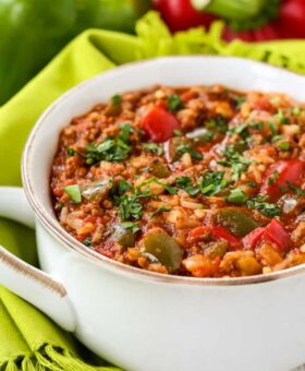 stuffed pepper soup in a white crock