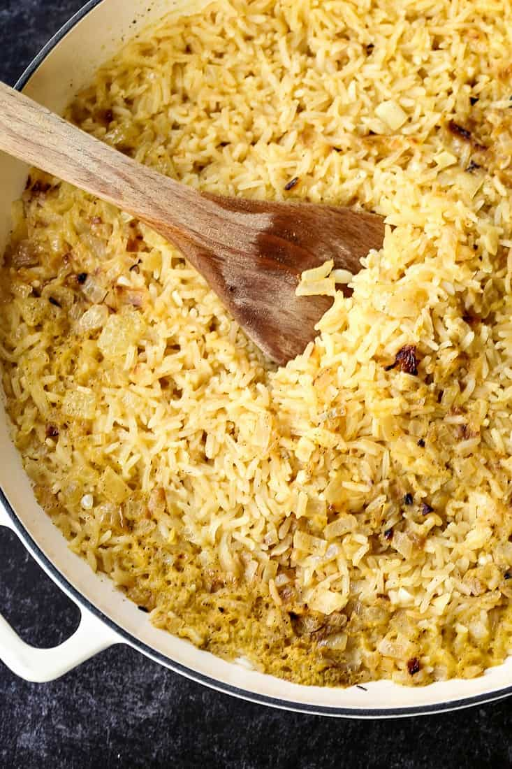 rice cooked in a dutch oven with chicken broth and onion