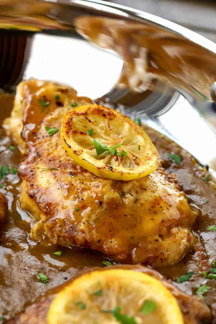 Chicken Francese recipe in a skillet with sauce